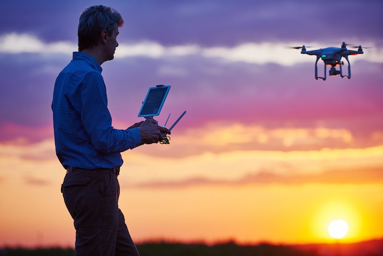 Man operating a drone in flight