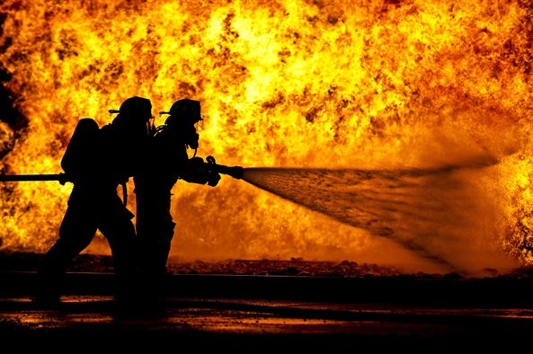 Firemen fighting a large fire